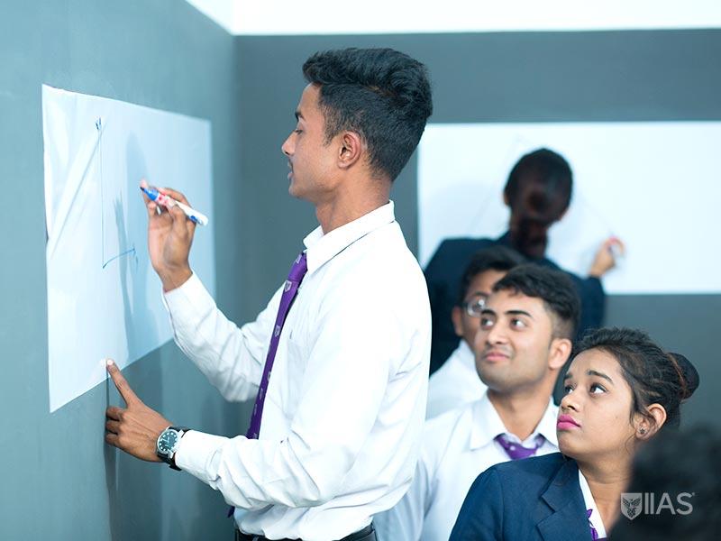 IIAS Siliguri students writing on whiteboard during English language class