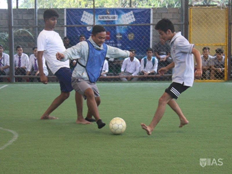 Students of IIAS Siliguri cheer their team during Futsal tournament